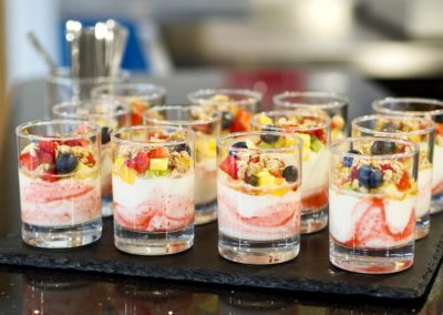Yogurt and fresh berries, topped with granola and a drizzle of honey italian catering uk london