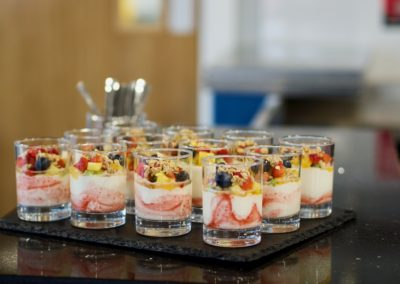 Yogurt and fresh berries, topped with granola and a drizzle of honey