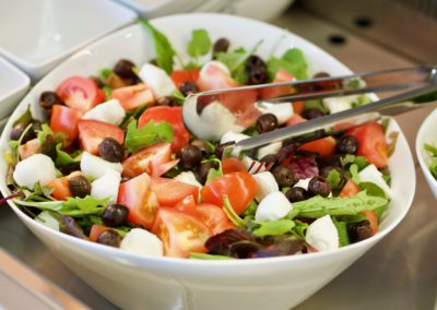 Mediterranean salad: lettuce, tomatoes, buffalo mozzarella and olives