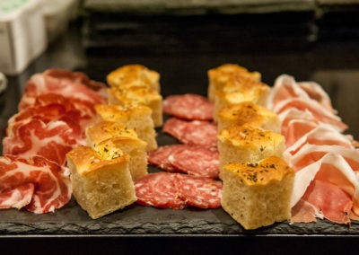 FOCACCIA AND CURED MEATS BOARD: SALAME FELINO, COPPA DI PARMA AND PARMA HAM