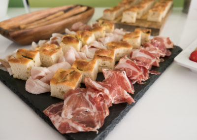 Rosemary focaccia and  Cured meats platters: prosciutto di Parma, Coppa di Parma